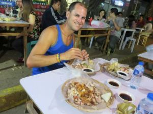 Dave eating Lechon in Cebu.
